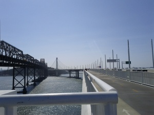 The old and new spans of the Oakland Bay Bridge with the bike trail on the left.