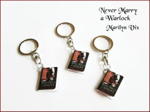 Never Marry A Warlock Keychain swag that can be won at the Multi-Genre/Author Book Celebration